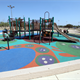 """Arnold Park Playground"" features colorfully designed play surface pads made from recycled rubber."
