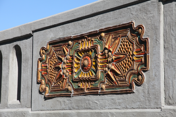 """Mill Race Bridge"" utilizes ceramic panels depicting complex and colorful Art Deco designs."