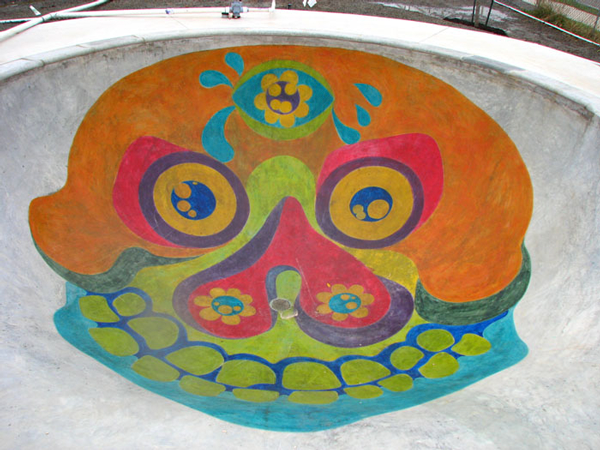"""Lackland Terrace Skate Park"" features a brightly colored Dia de Los Muertos design made from stained concrete."