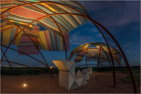 """Wickiup Overlook"" responds to the technology of the large cargo planes using blankets made from a hexagonal structural material often used in aircraft skin construction."