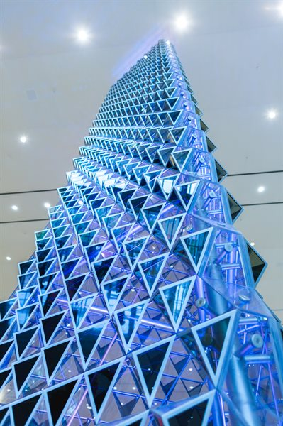 "Jason Bruges Studio of London's created ""Liquid Crystal,"" a 36 foot-tall tower-shaped sculpture."