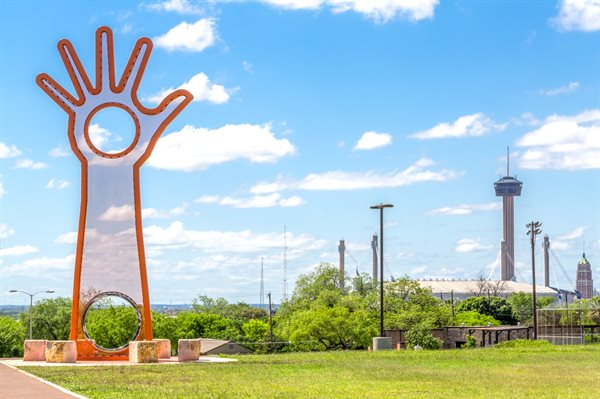 """Open Hand, Open Mind, Open Heart"" is a perforated steel hand, with 2 steel tube rings in the palm and at the base."