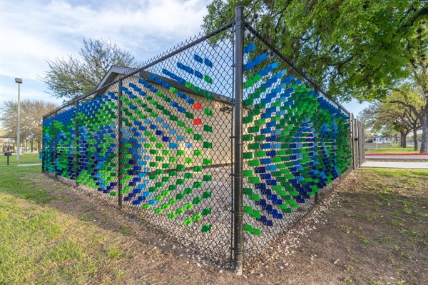 """Love is Never Lost"" is comprised of a special steel tab system that beautifies the fence with color and imagery."