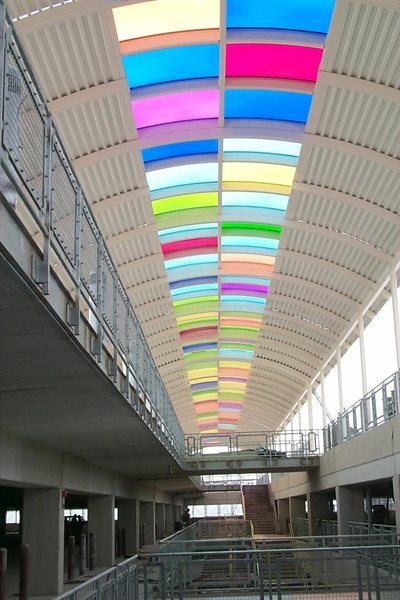 """Passing Light"" is an installation along Terminal 1 comprised of a festive colored skylight."