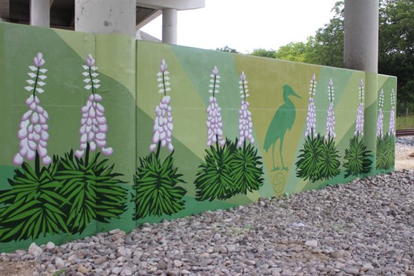 """Spring, Yucca, Heron"" is a mural drawing inspiration from native yucca and herons. The mural evokes the spring season."