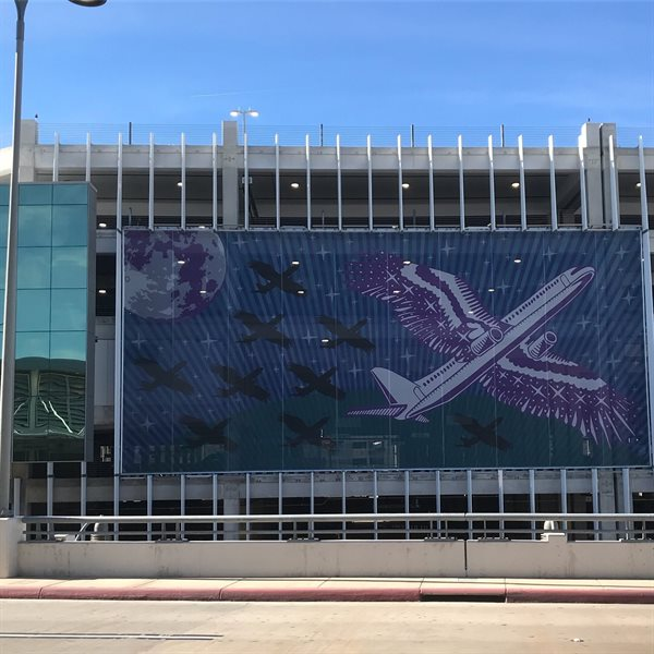 The exterior murals represent a hybrid bird/airplane bringing together ideas of nature and culture while recognizing the advances in technology.