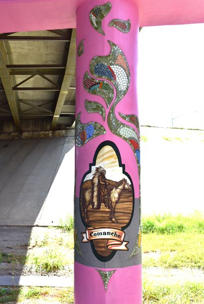 The imagery showcases history and heritage. This column features the Comanche, an indigenous tribe of the area.