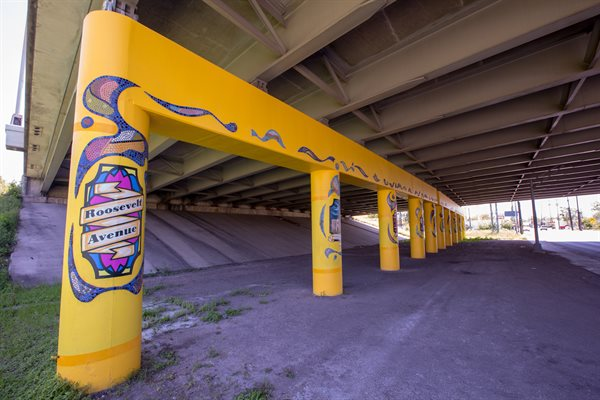 """Windows to Our Heritage"" is a series of underpass columns featuring mosaic patterns and vignettes of significant people and places from the surrounding areas."